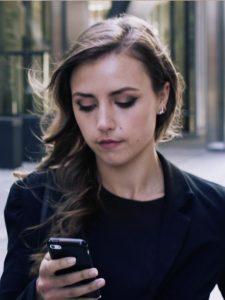 Business Women Checking An App , Application Development